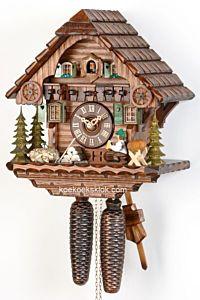 Schwarzwaldhuis met bierdrinker